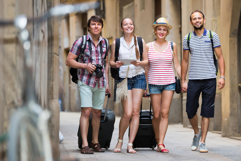 Group of positive people walking at the street royalty free stock image