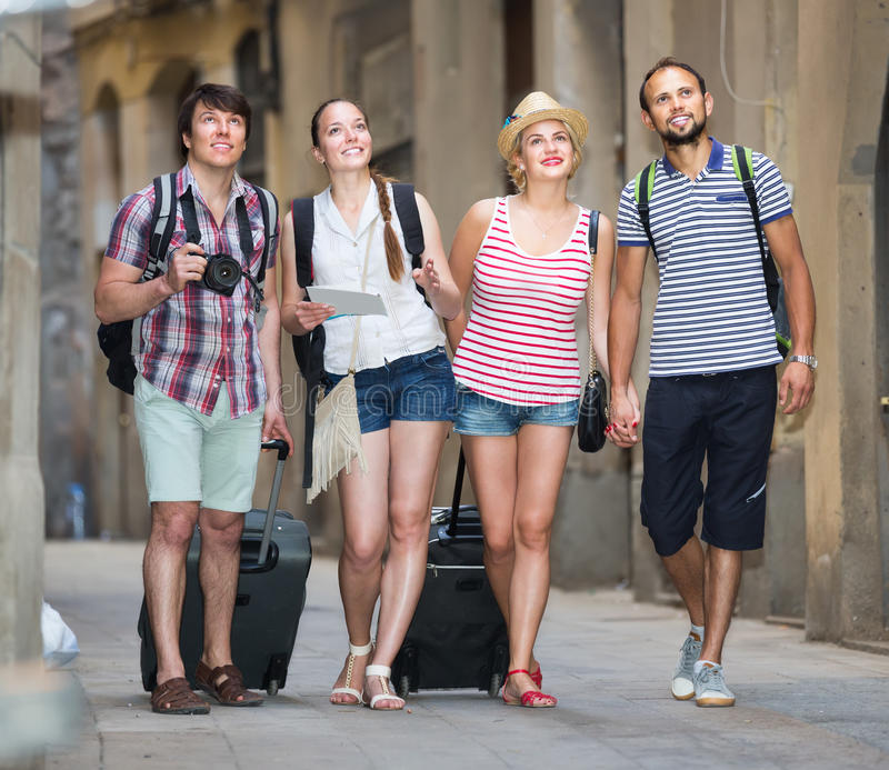 Group of positive people watching landmark stock images
