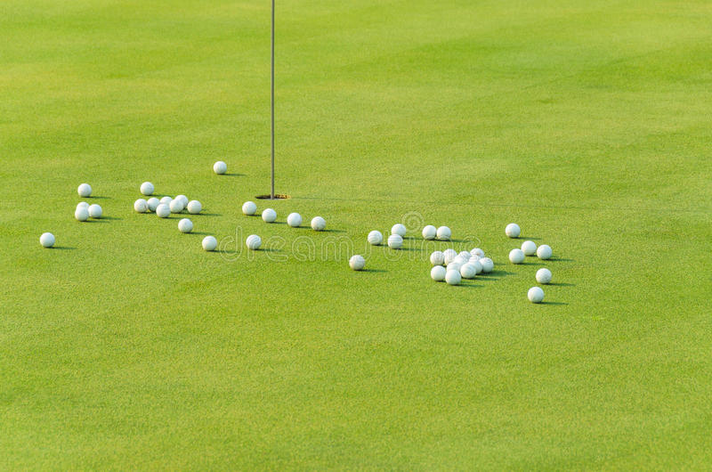 Group of practice golf ball on green royalty free stock photo