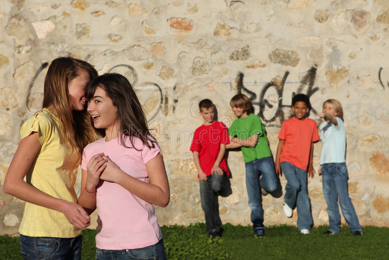 Group of pre teens whispering royalty free stock image
