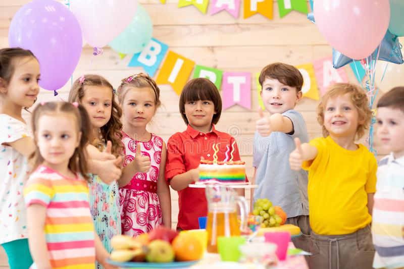 Group of kids celebrate birthday party together stock photography