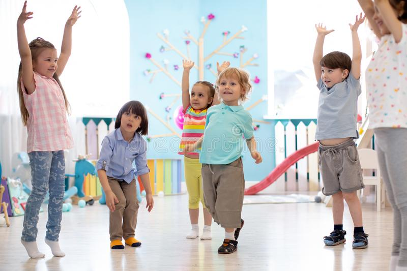 Group of children doing gymnastics in kindergarten royalty free stock images