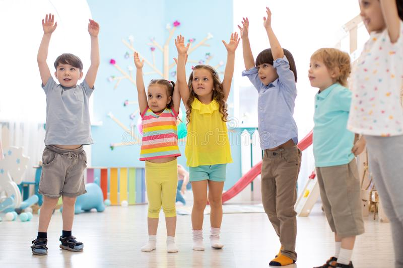 Group of children doing kids gymnastics in gym royalty free stock images