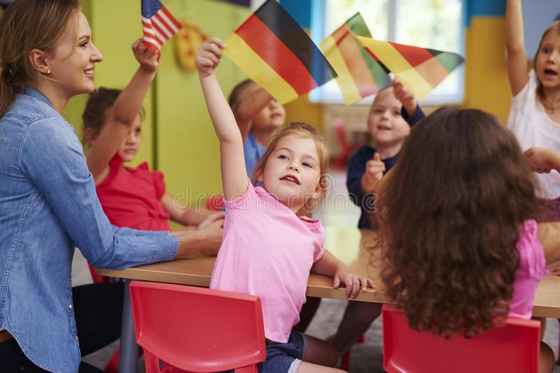 Group of  preschool children learn languages. In the preschool stock photography