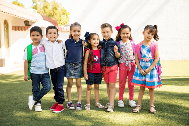 Group of preschoolers hanging out outdoors stock photos