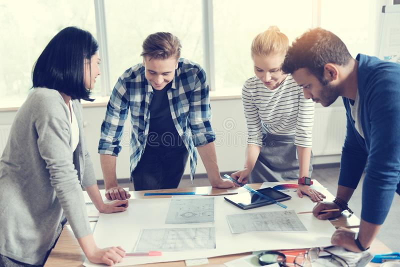 Group of professional designers working together royalty free stock images