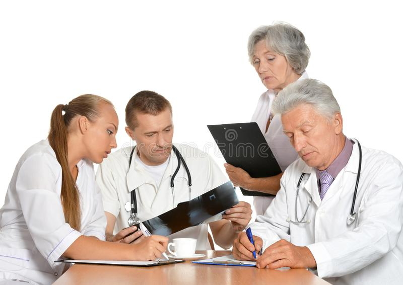 Professional doctors looking at x-rays royalty free stock photo