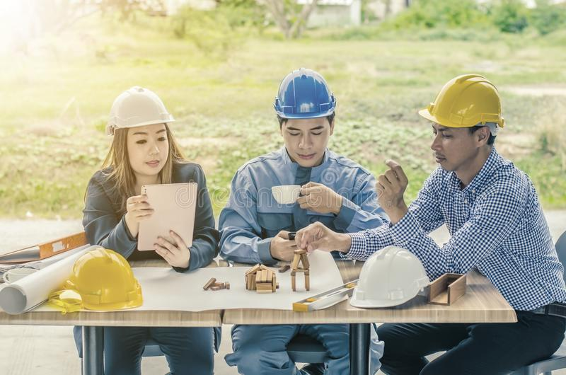 Professional engineer are discussing the project building plan with his business client stock image