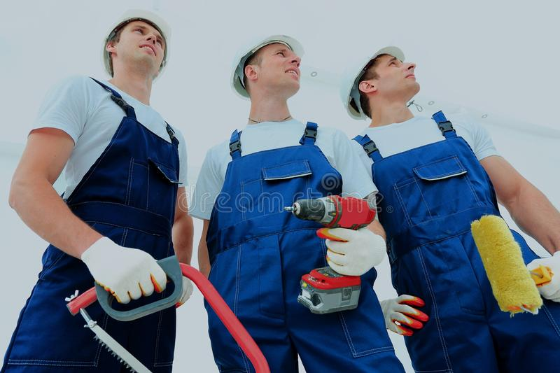 Group of professional industrial workers. Isolated over white background. royalty free stock photography