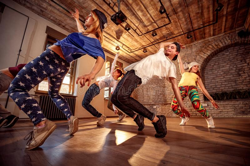 Professional people exercising dance training in studio stock photos