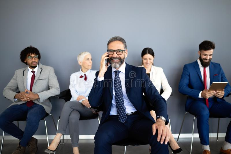 Group of proffesional business people communicating in modern office royalty free stock image