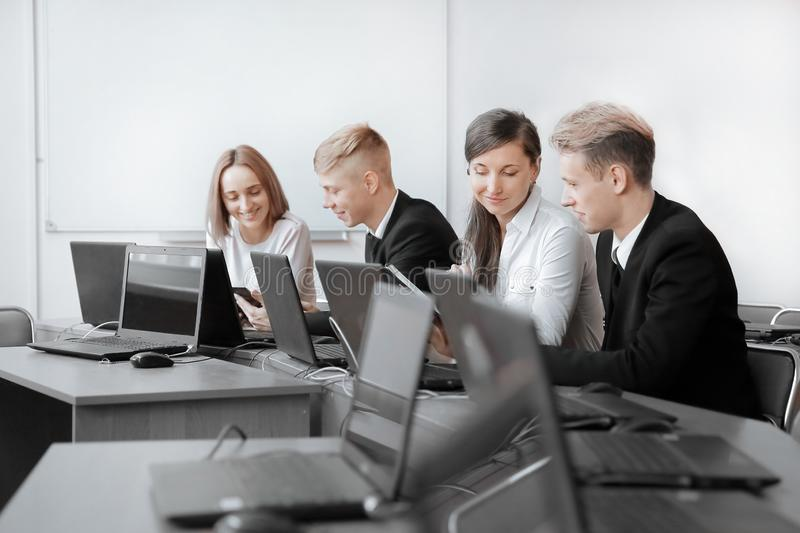 Group of Programmers working in the office of the software developer. stock images