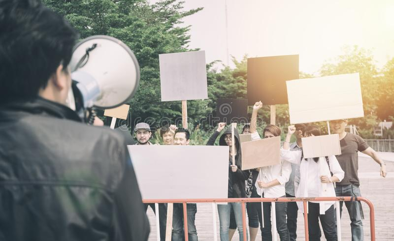 Group of protesters walking at the street. Group of protesters holding protest signs walking at the street royalty free stock image