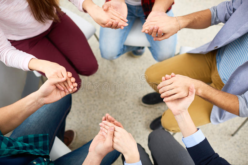 Group psychotherapy. Human hands held together during group psychotherapy stock photo