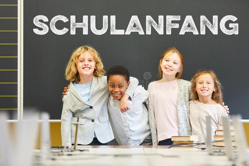Group of pupils in front of blackboard at the beginning of school. Happy group of pupils in front of blackboard at the beginning of school royalty free stock photo
