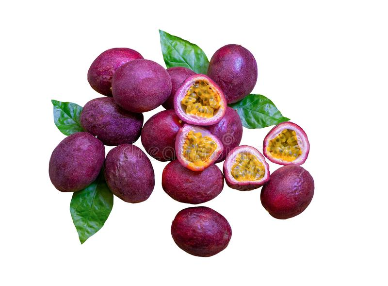 A group of purple skin passionfruit plant, sliced and round fruits isolated on white background, die cut with clipping path royalty free stock photos
