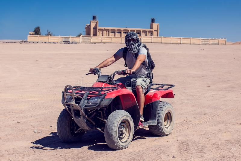Man on bikes drives in the desert stock photo
