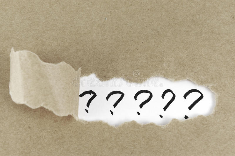 Group of question mark. Teared paper with group of question mark behind it royalty free stock photo