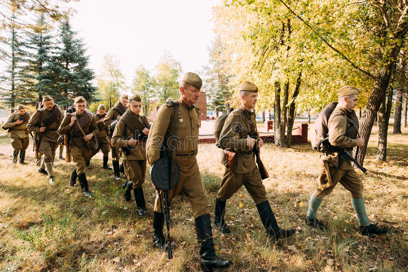 Group Of Re-enactors Dressed As Soviet Russian Red Army Infantry. Dyatlovichi, Belarus - October 1, 2016: Group Of Re-enactors Dressed As Soviet Russian Red Army stock photo