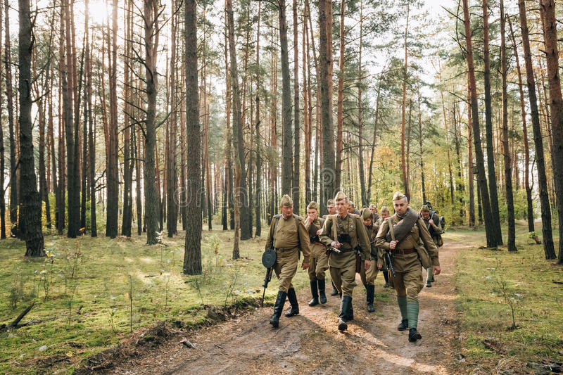 Group Of Re-enactors Dressed As Soviet Russian Red Army Infantry. Dyatlovichi, Belarus - October 1, 2016: Group Of Re-enactors Dressed As Soviet Russian Red Army royalty free stock photo