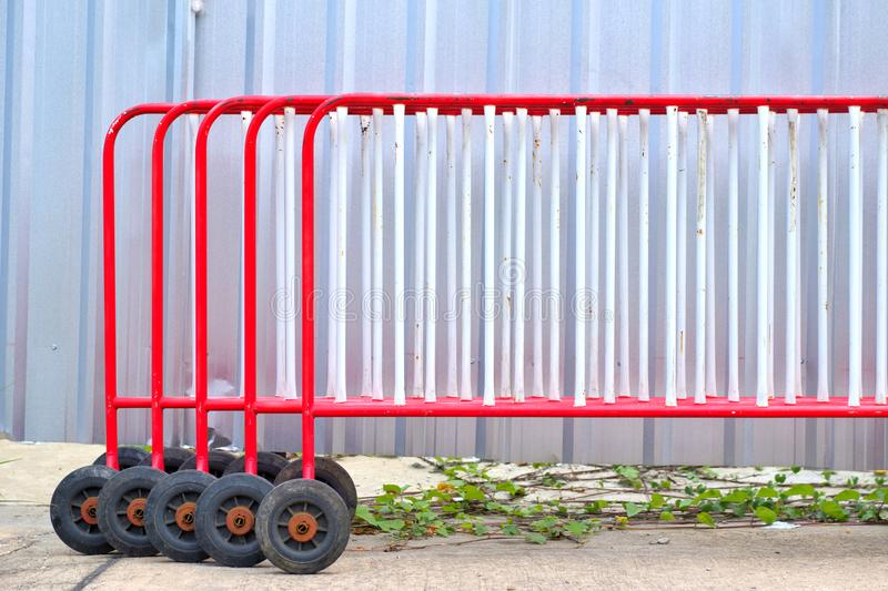 A group of red traffic barrier. Using for keep vehicles within their roadway and prevent them from colliding with dangerous royalty free stock image