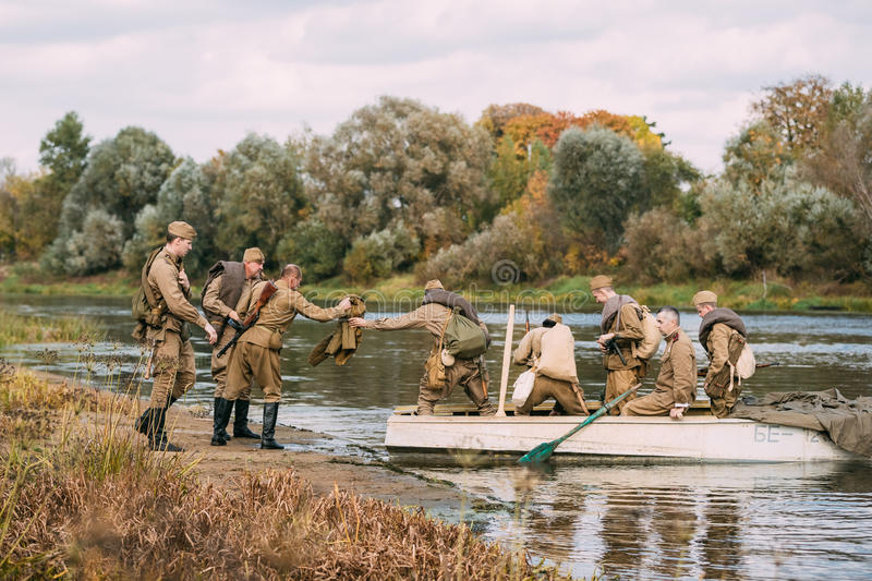 Group Of Reenactors Dressed As Russian Soviet Red Army Infantry. Dyatlovichi, Belarus - October 1, 2016: Group Of Men Reenactors Dressed As Russian Soviet Red stock photos