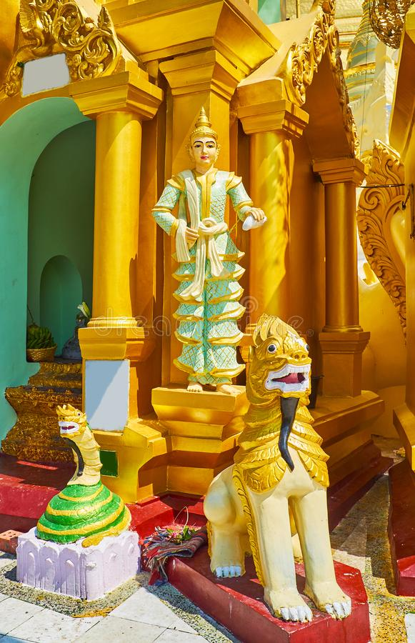 Religious sculptures in Shwedagon, Yangon, Myanmar. The group of religious statues at the small outer stupa of Shwedagon Zedi Daw: the Naga-Raja snake, Chinthe stock images