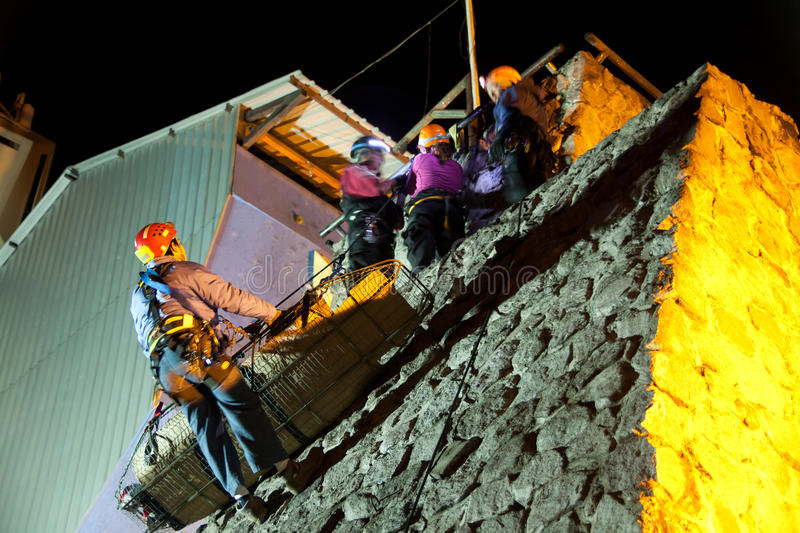 Group of rescuers. Doing night rescue exercises royalty free stock images