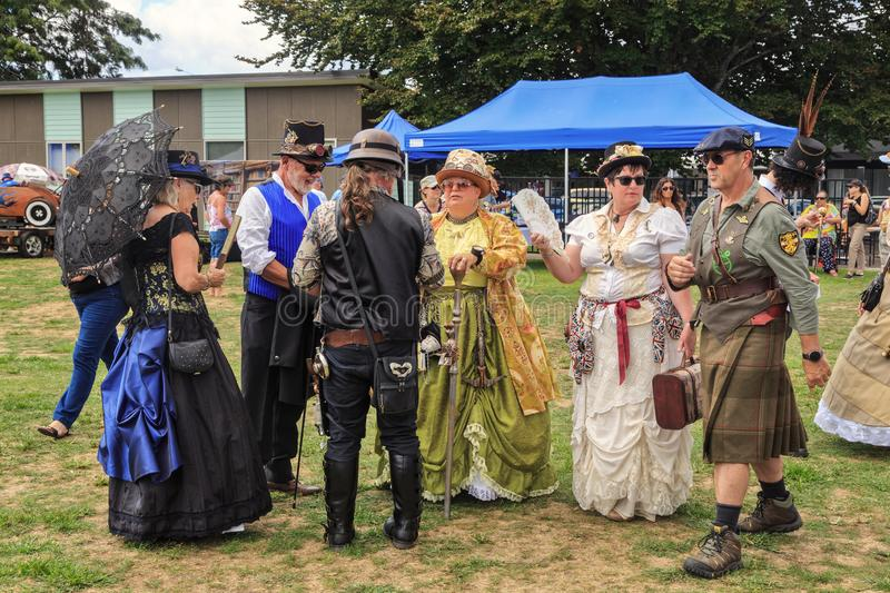 Men and women in quirky retro and steampunk outfits royalty free stock images