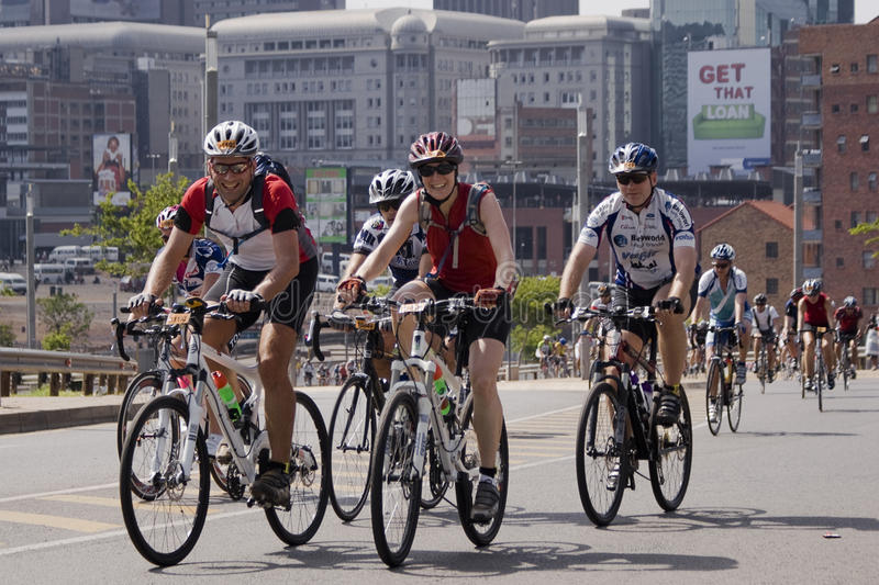 Group of Riders - 94.7 Highveld Cycle Race. Riders participating in the annual 94.7 Highveld Stereo, 94.7km cycle race. Over the Nelson Mandela Bridge, with stock photo