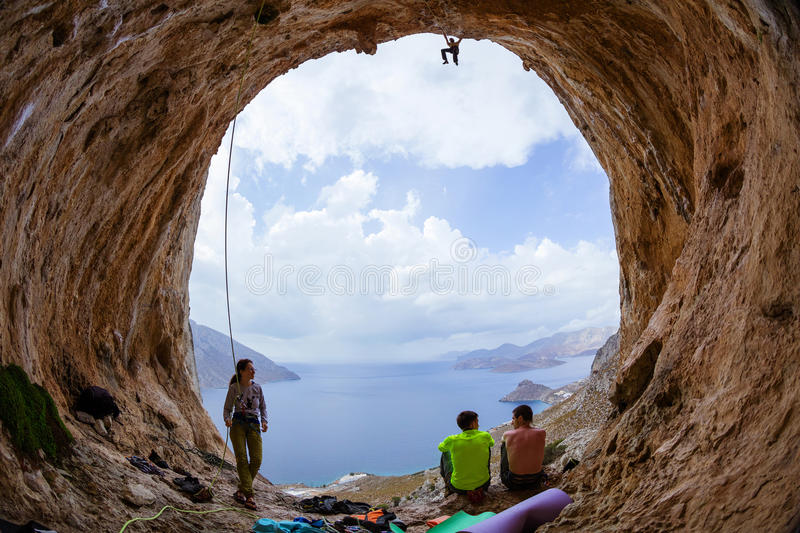 Group of rock climbers in cave royalty free stock photography