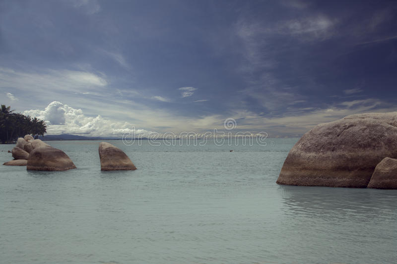 Group of Rocks on the Beach. Group of rocks under a blue sky on the beach stock photography