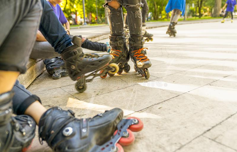 Group of roller skates sitting and resting in outdoor skate park, Close up view of wheels before skating. Selective focus royalty free stock photo