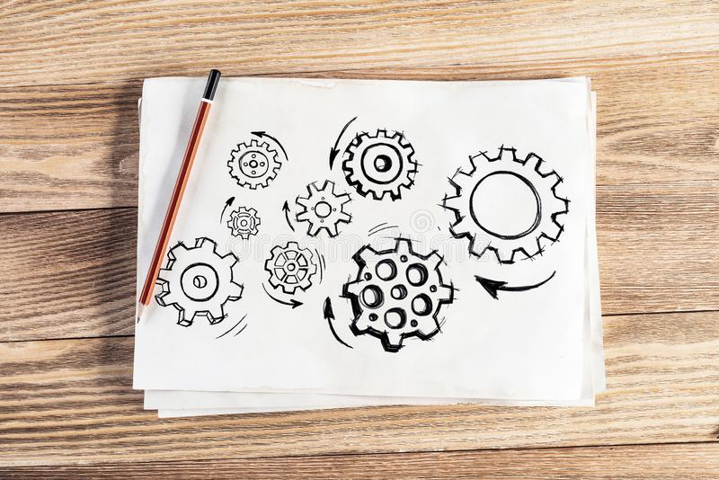 Group of rotating gears pencil hand drawn stock photo