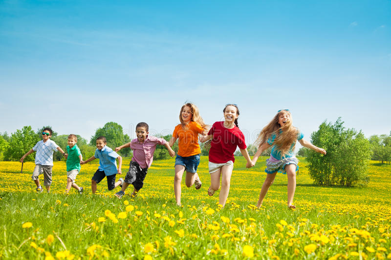 Group of running kids stock image