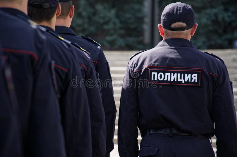 A group of Russian cops is preparing to work at the meeting. View from the back stock image