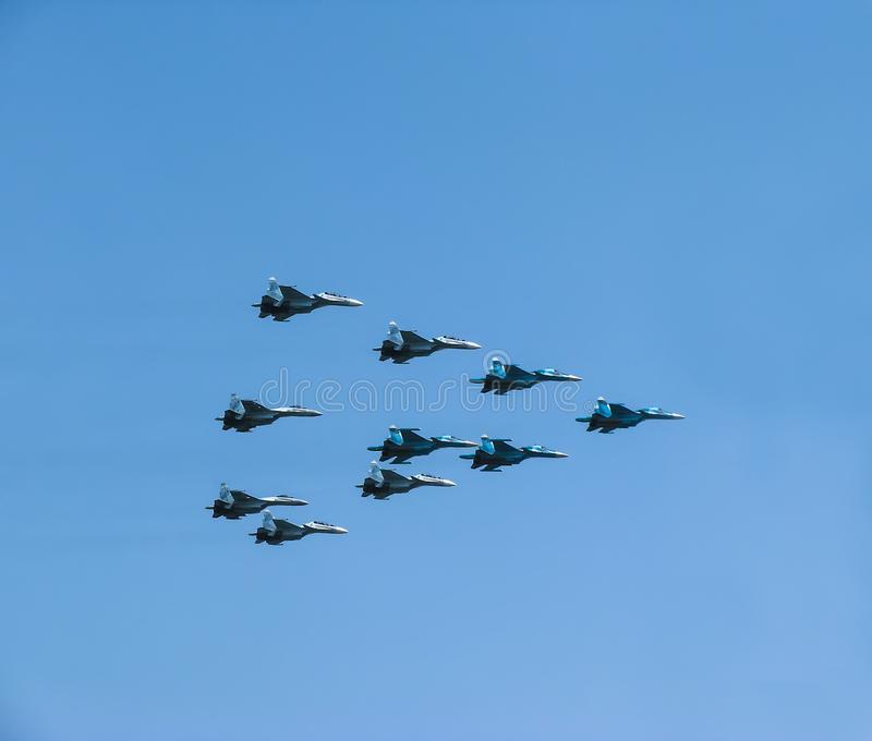 A group of Russian military aircraft fighter planes in the sky. A group of Russian fighter planes in the front line against a clear sky royalty free stock photo