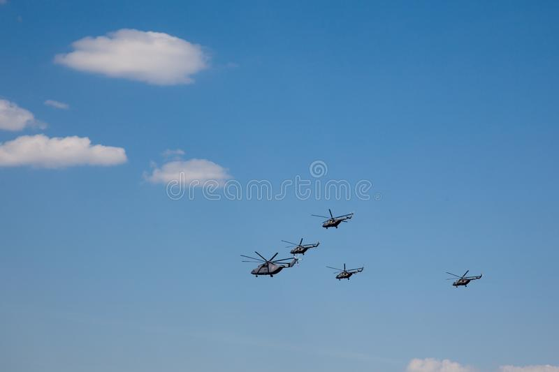 Group of russian military helicopter against the blue sky stock image