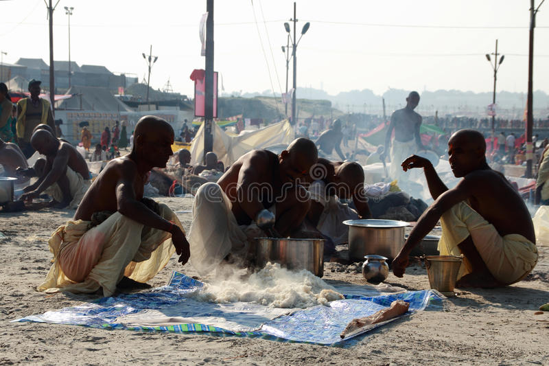 A group of Sadhus make food at Kumbh Mela. Ground on February 08, 2013 in Allahabad, India. Kumbh Mela is considered as the largest human gathering in the world stock photo