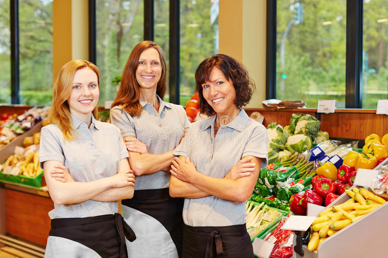 Group of sales women in supermarket royalty free stock photography