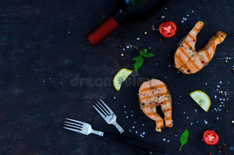 Group salmon steaks pepper salt top view on dark background space. Group salmon steaks pepper salt top view on dark background royalty free stock images