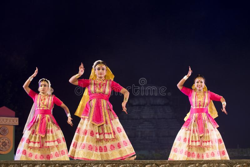 Group of Sattriya Dancers performing Sattriya Dance on stage at Konark Temple, Odisha, India.An assamese classical indian dance. royalty free stock photo