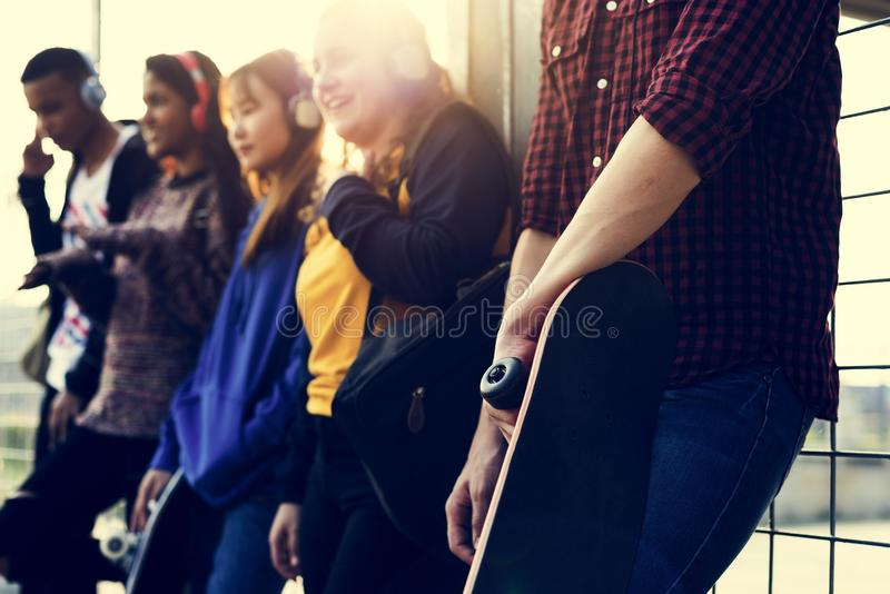 Group of school friends outdoors lifestyle and music leisure con royalty free stock image