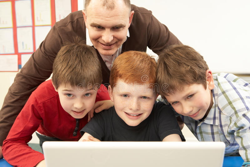 Download Group Of Schoolboys In IT Class Using Computer Stock Image - Image: 18030655