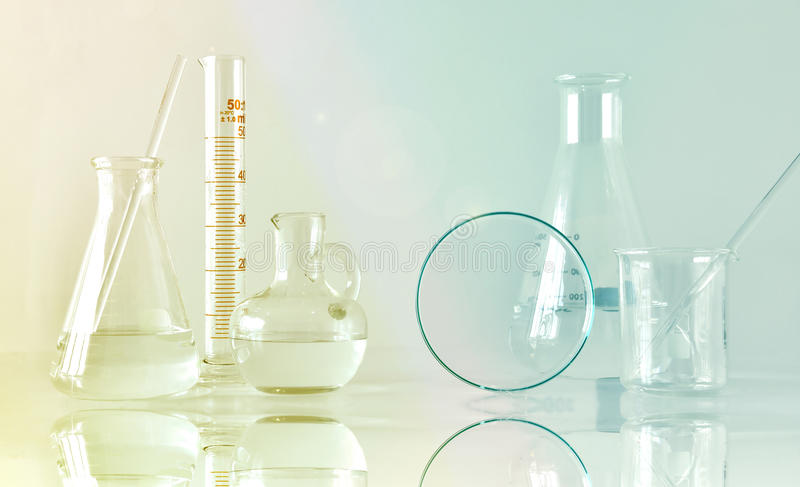 Group of scientific laboratory glassware with clear liquid solution, Research and development. Concept stock photography