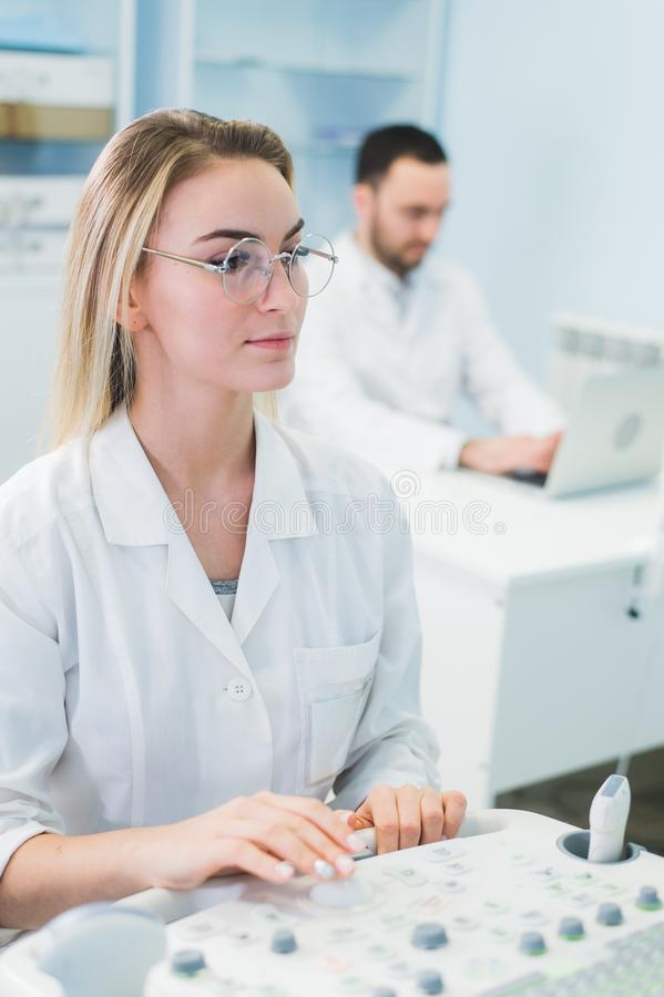 Group of scientists working at the laboratory stock photos