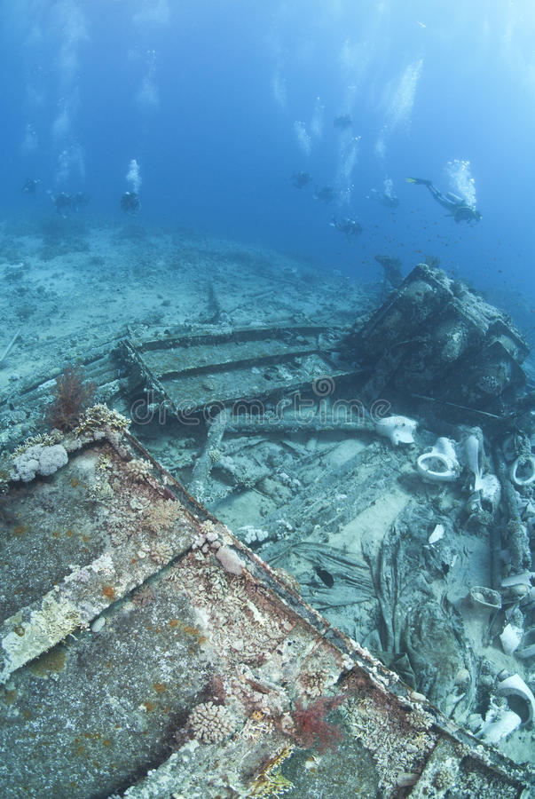Download Group Of Scuba Divers Exploring A Shipwreck. Stock Photography - Image: 16719302