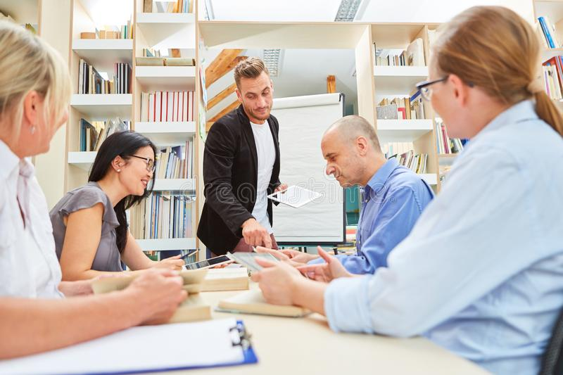 Group in a seminar for adult education stock photo