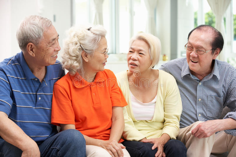 Group Of Senior Chinese Friends Relaxing At Home Royalty Free Stock Photography