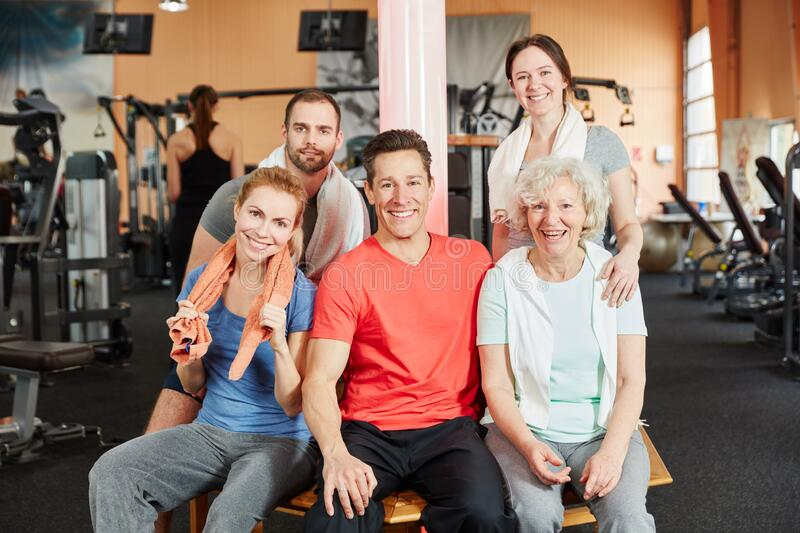 Group with senior in fitness center stock image